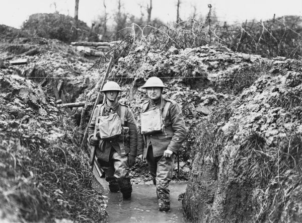 Lancashire fusiliers in a flooded communication trench showing wire. Opposite Messines near Ploegstreert Wood, Belgium during World War I in January 1917