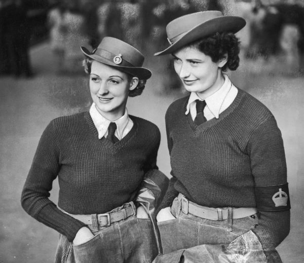 "Two former mill workers, sisters Ava and Blanche Horn, (""first 'Bevin' girls""- Land Army conscripts & volunteers) are photographed in London enroute for the 'south&#39"