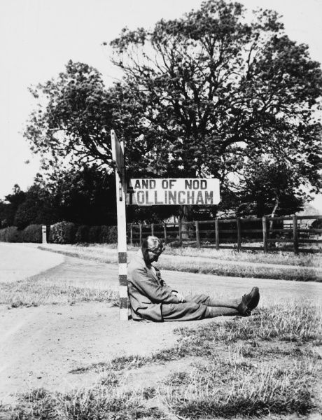 The Land of Nod is one way to describe the dream world. Here the signpost points to a village of the same name in East Riding, Yorkshire. But is the man really asleep?