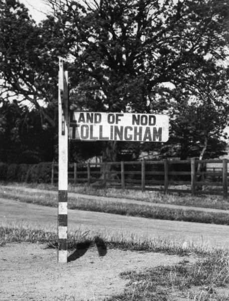 A signpost pointing the way to the 'Land of Nod', a remote hamlet in the East Riding of Yorkshire, England. Date: 1950s