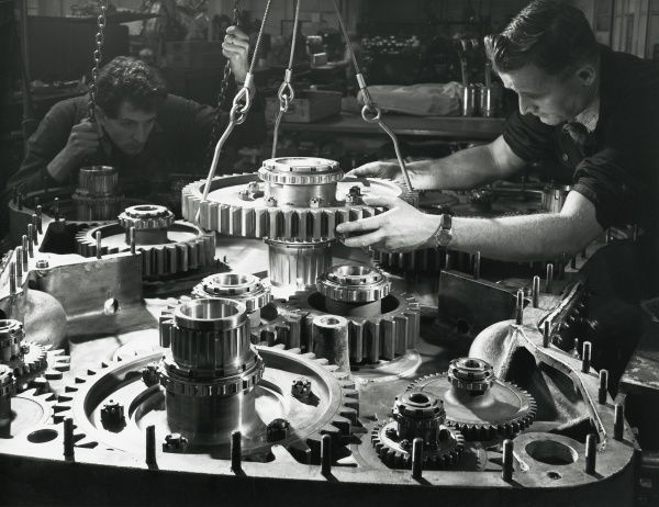 Two fitters assemble the large output pinion into the phasing gear case of a Deltic engine Date: 1960