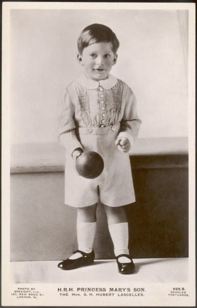 GEORGE HENRY HUBERT LASCELLES later 7th EARL of HAREWOOD Elder son of 6th Earl Harewood and Princess Mary, playing with a ball