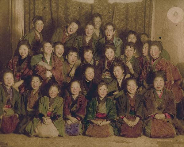 Laughing young men and women in kimonos
