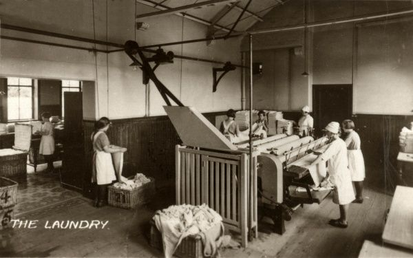 The laundry at the Orphan Homes of Scotland, Bridge of Weir, Renfrewshire. Items came to the laundry for finishing after first being washed in the wash house. The Homes, laid out as a village of 'cottage homes', were opened in 1878 by William Quarrier