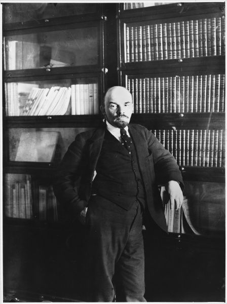 VLADIMIR ILICH ULYANOV LENIN Soviet statesman, in a relaxed pose, in front of a bookcase in his study