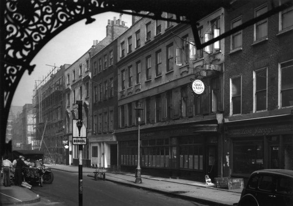 Peppino Leoni's Quo Vadis restaurant on Dean Street, Soho, London in 1947. It is next door to Leon Jaeggi, kitchen equipment, tinner and coppersmith, and Townsends