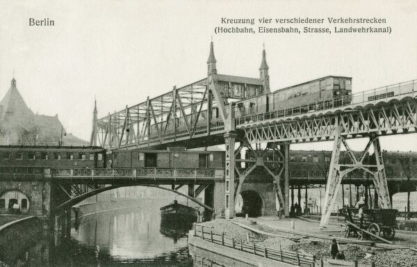 Elevated railway in Berlin, Germany, crossing another railway, which itself is crossing a brige above a canal!