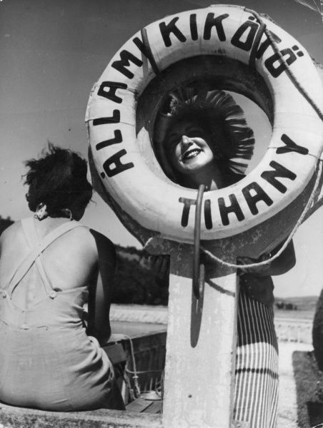 Young women larking about with a lifebuoy at a seaside resort in Hungary. Date: 1930s