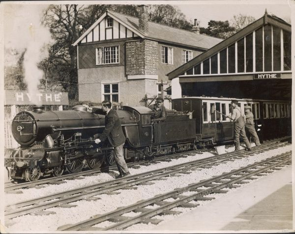 The 'Lilliputian' steam locomotive train, in its day the smallest in the world, on the Romney, Hythe and District Railway, Kent, England, being spruced up for the holidays