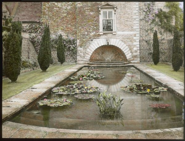 View of a lily pond in the formal gardens at Abbotswood, Stow on the Wold, Gloucestershire. The gardens were created by Sir Edwin Lutyens