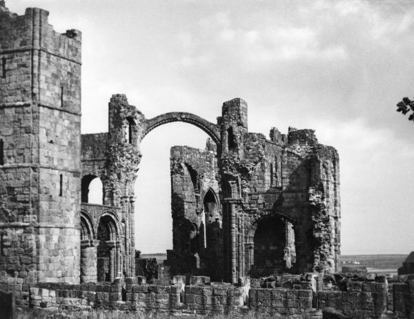 The beautiful ruins of Lindisfarne Priory, on the island of Lindisfarne (or Holy Island), off Northumberland, England. Built in 1093 on site of a 7th century monastery. Date: founded 1093
