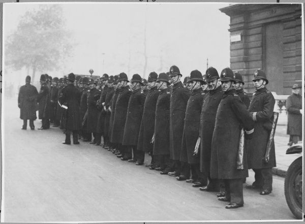 Line of Metropolitan Police officers on duty in London