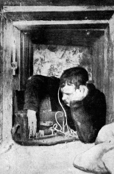 British soldier using a microphone to listen for evidence of enemy counter-mining underground. Underground mines became a major feature of warfare on the Western Front during World War I with miners and tunnel-workers recruited from Britain