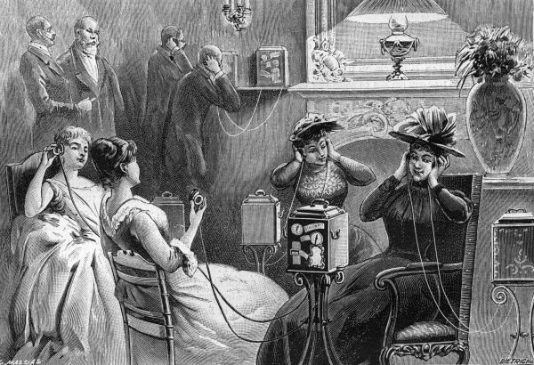 Ladies listening to the Theatrephone, piping in music from concert halls, drama from theatres, singing from opera houses... Date: 1892