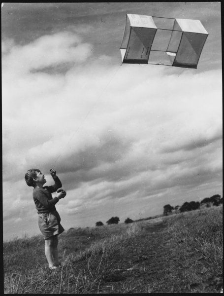 A young boy experiences the joy of making his kite fly