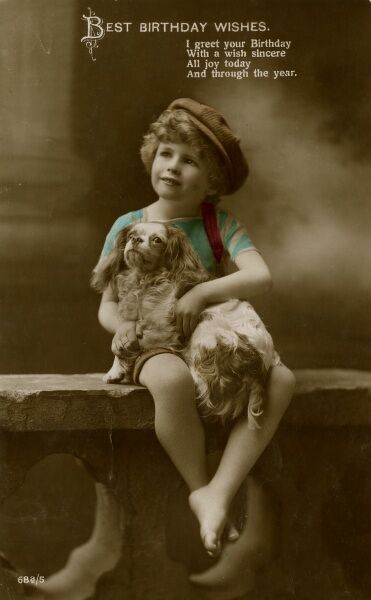 A little boy with a King Charles spaniel on a birthday postcard. (1 of 2) Date: early 20th century