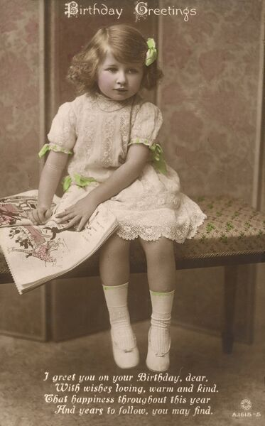 A little girl on a Birthday Greetings postcard sits on a bench with a magazine at her side