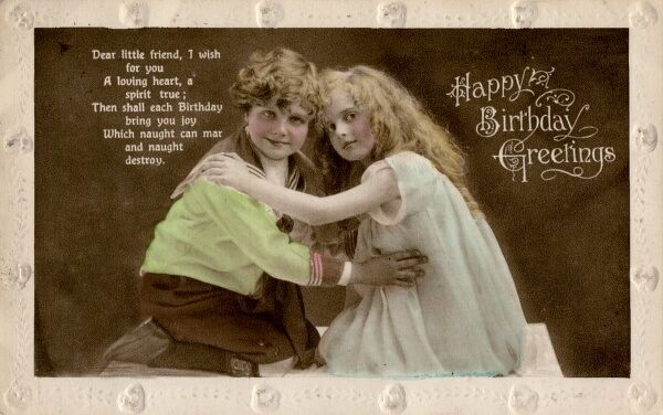 A little girl and boy kneeling face to face hugging each other on a birthday postcard. He is in a sailor suit