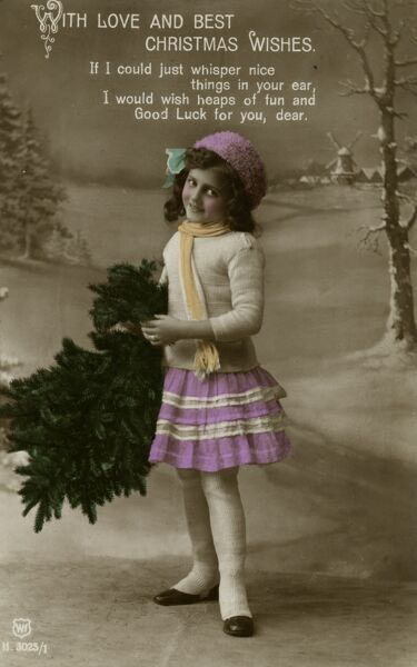 A little girl on a Christmas postcard. She is standing in a winter landscape holding a small Christmas tree. Date: early 20th century