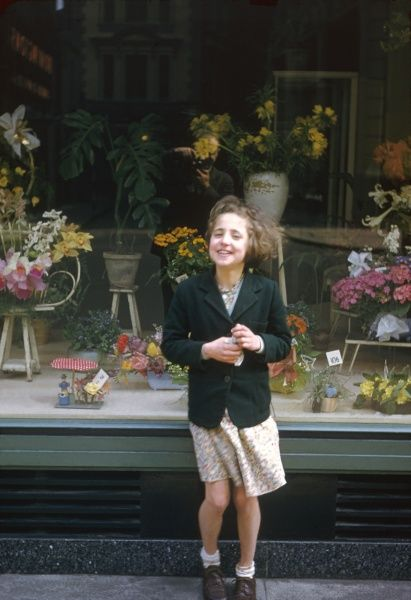 A little girl poses for her photo outside Selfridges department store in Central London. Photograph by Heinz Zinram
