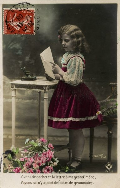 A little girl writes a letter to her grandmother, and makes sure to check her grammar before posting it. Date: 1908