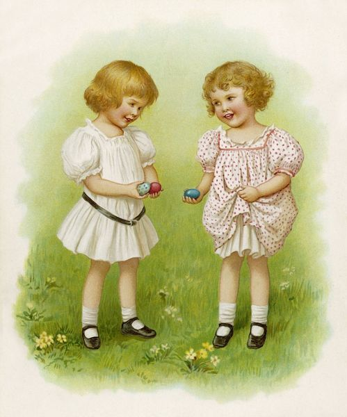 Two little girls with their Easter eggs out in the garden