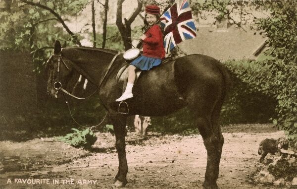 Little Patriotic Girl astride a cavalry horse, holding a Union Flag and playing a side drum. Her feet are nowhere close to reaching the stirrups! Date: circa 1914