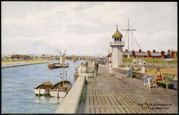 A paddle steamer chugs up the harbour beside the pier at Littlehampton, West Sussex