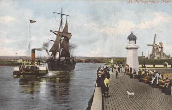 At Littlehampton Pier (which is complete with windmill and lighthouse), a steam tugboat brings a large sailing ship safely into port. Date: circa 1910s