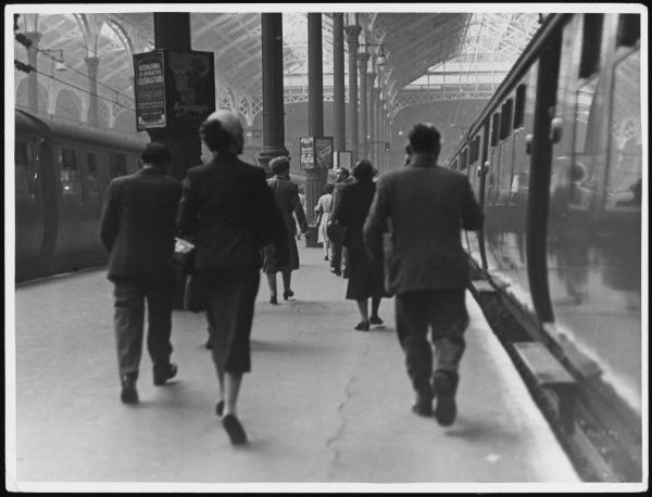Smartly-dressed passengers walking along one of the platforms at Liverpool Street Station