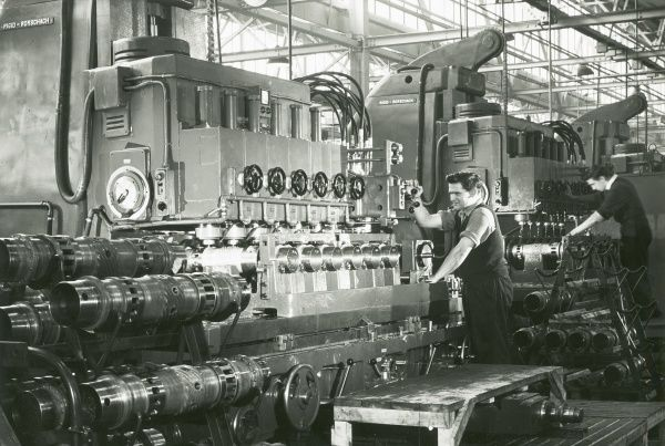 Liverpool Works, two men operating Deltic sleeve port-milling machinery Date