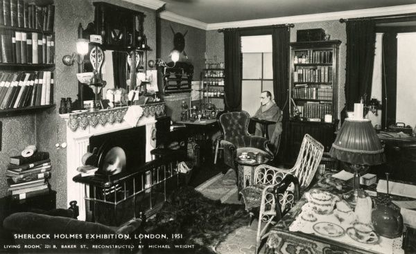 Living Room of 221B Baker Street, part of a Sherlock Holmes Exhibition, London, reconstructed by Michael Weight. A dummy version of the man himself can be seen in the far window. Date: 1951