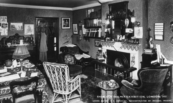 Living Room of 221B Baker Street, part of a Sherlock Holmes Exhibition, London, reconstructed by Michael Weight. Details included are Holmes's pipe and his violin. Date: 1951