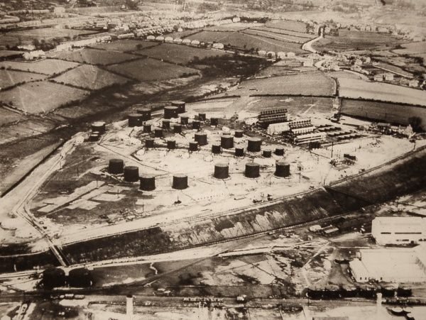 The 'tank farm' at the Llandarcy Oil Refinery, Swansea, Wales - built by British Petroleum Oil between 1918-22