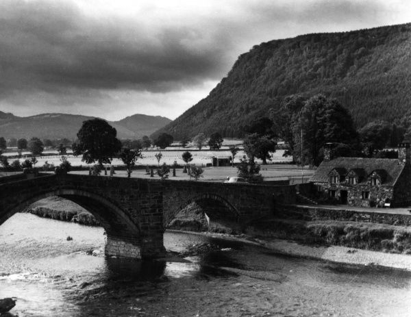 Llanrwst Bridge, over the River Conwy, a stone bridge, built c. 1636. The Ty Hwnt ir Bont, 15th century buildings, now a National Trust property and tearooms, on the right. Date: 17th century