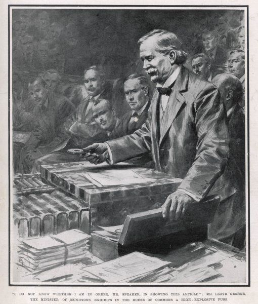 David Lloyd George, at this time Minister of Munitions, exhibits a high-explosive fuse in the House of Commons