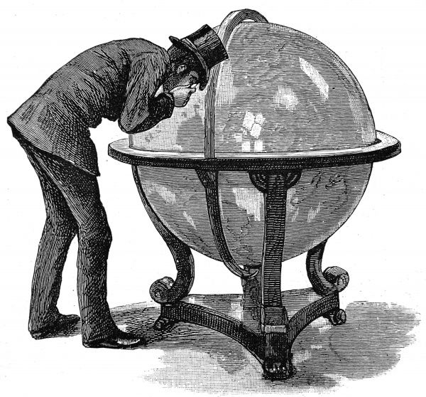 Engraving showing a Lloyd's of London insurance underwriter, closely examining a globe of the Earth, 1886