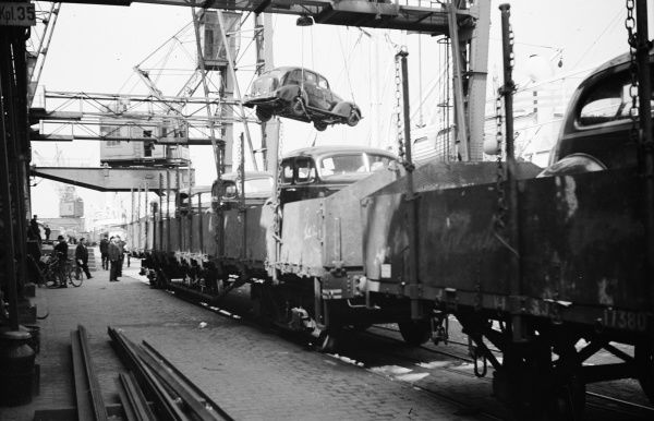 Imported cars are loaded on railway goods wagons, Landskrona Harbour, 1935. Date: 1935