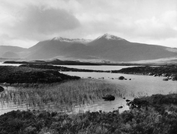 View across the waters of Loch Tulla, at Black Mount, Argyllshire, Scotland, with snow on the peaks of Stob Ghabbar and Clach Leathad. Date: 1960s