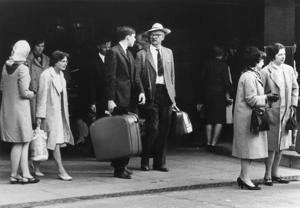 Passengers with their luggage at London (now Heathrow) Airport, England. Date: 1960s