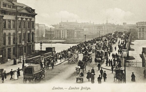 London Bridge, heavy with traffic, both vehicular and pedestrian