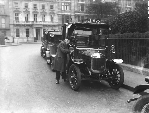 A taxi rank of 'old' London motor cabs