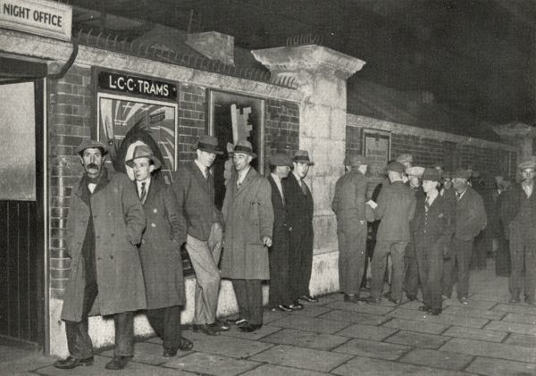 Applicants waiting outside the London County Council's Night Office at Charing Cross Bridge, Central London. The Office had telephone links to the city's casual wards, as well as to the Salvation Army, Church Army, and other voluntary organisations