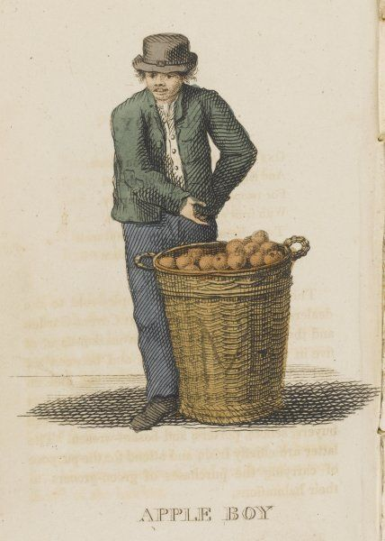 The apple boy sells apples from a basket