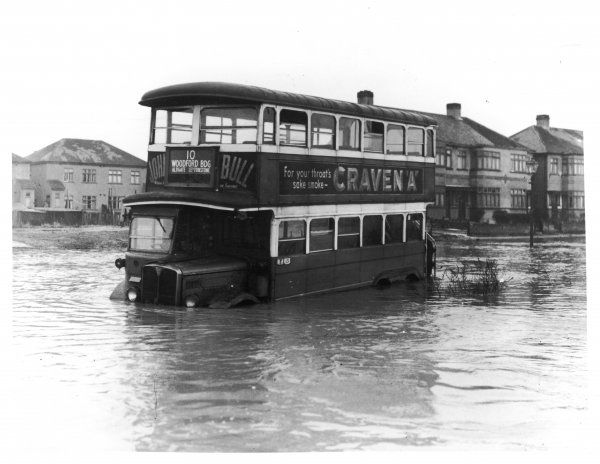 A No 10 London bus, which had been on its way to Woodbridge before it was abandoned in a suburban street during the 1947 floods