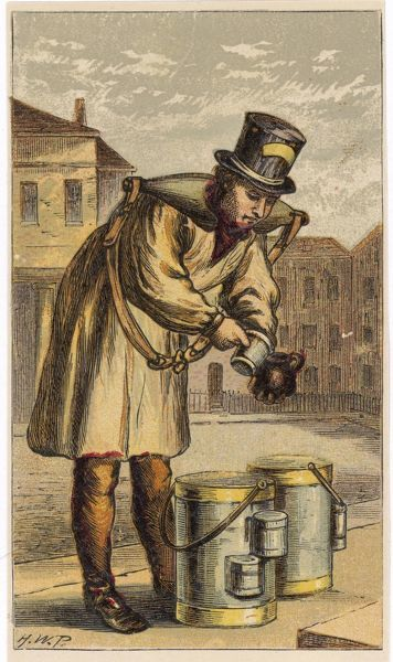 A London milkman pours milk from his pails into a cup