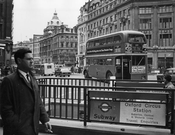 The hustle and bustle of Oxford Circus, Oxford Street, central London. Date: mid 1960s