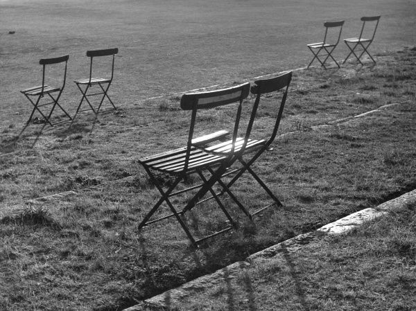 Waiting for sundown! A study of chairs in a London park. Date: 1950s