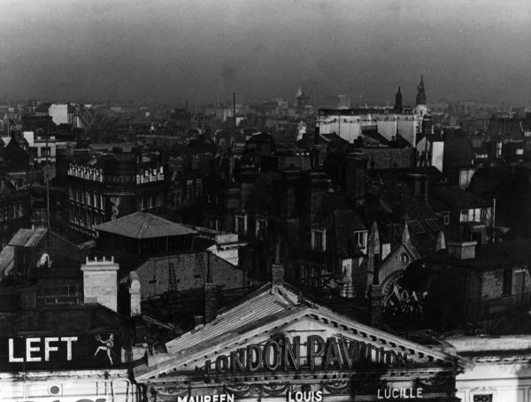 A view over central London rooftops with the London Pavilion (now part of the Trocadero Centre), on the corner of Shaftesbury Avenue and Coventry Street at Piccadilly Circus, in the foreground