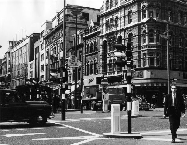 Traffic lights in the St. Giles Circus area, near Tottenham Court Road and Oxford Street, central London. Date: mid 1960s